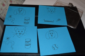 A4's chore cards showing watering and feeding George and Lucy (the cats) and Oscar, cleaning the cat litter ( I will do this, but with her helping) and throwing some balls for Oscar