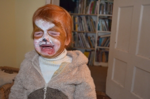 A1 crying because, by accident, she had wiped a lot of her face paint off all over our velvet arm chair!