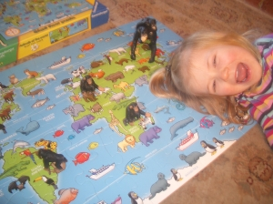 Then she found the monkey families on the map, told me which continents they were from and I showed her which continents had no pistures of any monkeys. She then placed her own toy monkeys on the continents which had monkeys living there.