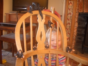 Using the chair as a tree, she pretended her family of monkeys was our family. Apparently Daddy was the monkey on top of the 'big' Mummy's' back!!