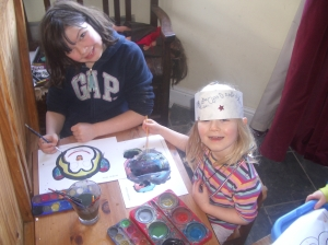 Monkey mask making with her sister