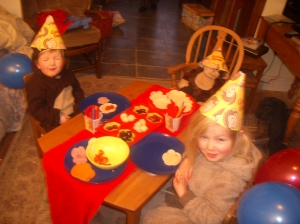 Our two mischief making monkeys at their very own tea party