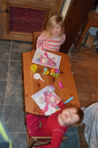 Making snowmen with white playdough and snowman cutters