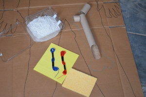 I collected supplies from around the house:  papier mache, red and blue thread, a red straw, two sponges with different thicknesses