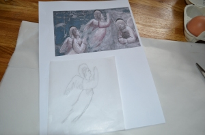 Tracing the angel onto tracing paper