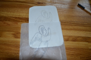 Tracing it from tracing paper onto plaster