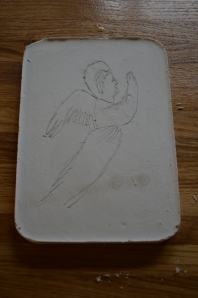 We painted a very thin layer of very thin plaster on top of the damp p[laster, so the angel picture still showed through