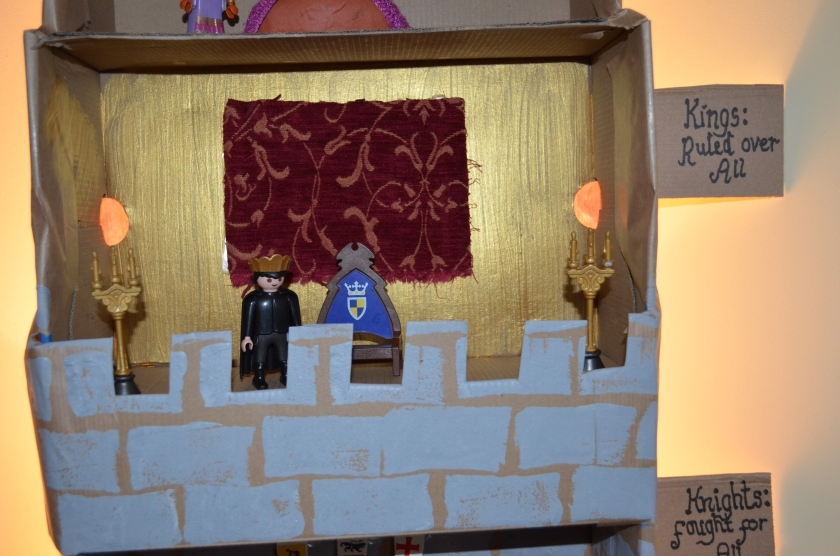 The king who ruled over all....We painted the room golden, hung a tapestry up at the wall, had a playmobil throne and king and added some candles for good measure!