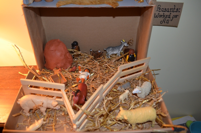 And peasants who worked for all....We lay straw on the floor, made a clay dwelling, added animals and fenced off areas.