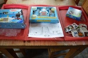 Thomas floor puzzle, colouring sheets with a full art set for the children to choose which medium to use, a Thomas pairs game