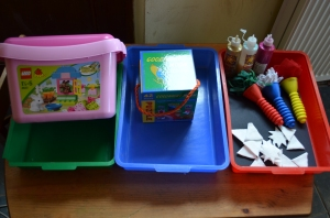 Trays from left to right:  Bunny Lego; Goodnight Moon puzzle; paint effects night sky
