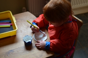 B2 painting her moon with flour and white paint