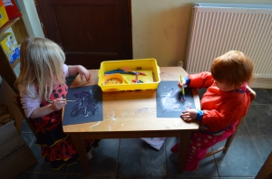 Preparing their night sky with some glitter glue