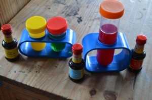 Test tubes full of vinegar coloured with food colouring