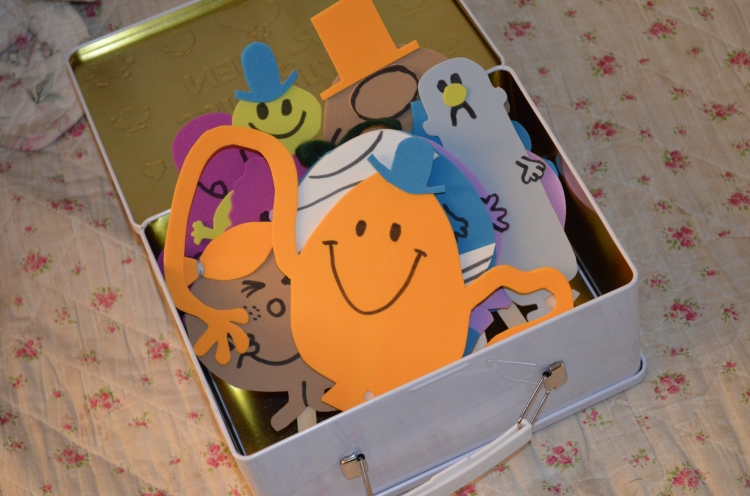 Our tin box filled to the brim with our hand-made puppets