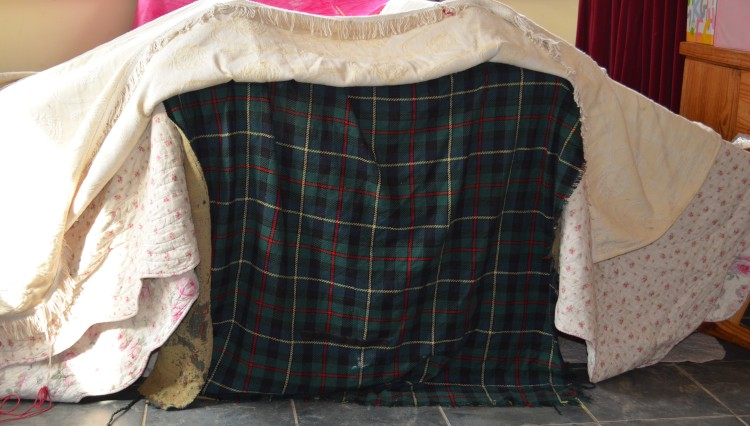 They lent all the chairs against the table at an angle and draped every cloth we had in the house over it.  They made a door using a contrasting woollen tartan