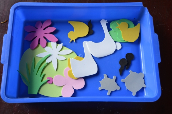 This tray activity was for use on the white board.  I cut out pond themed shapes from foam and gave A4 some water to help them stick.