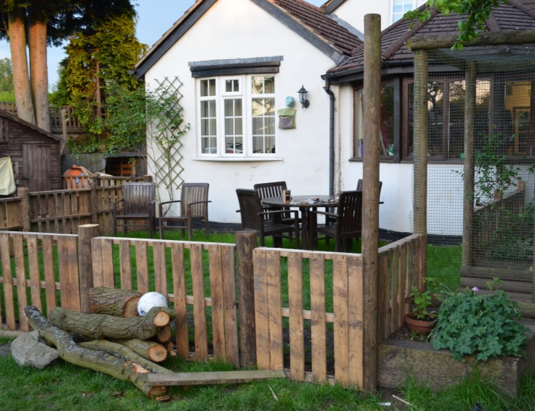 First he made a fence around a small area of our garden, to partition some space off for picnics and the such.  An area the children will not be allowed to play in.