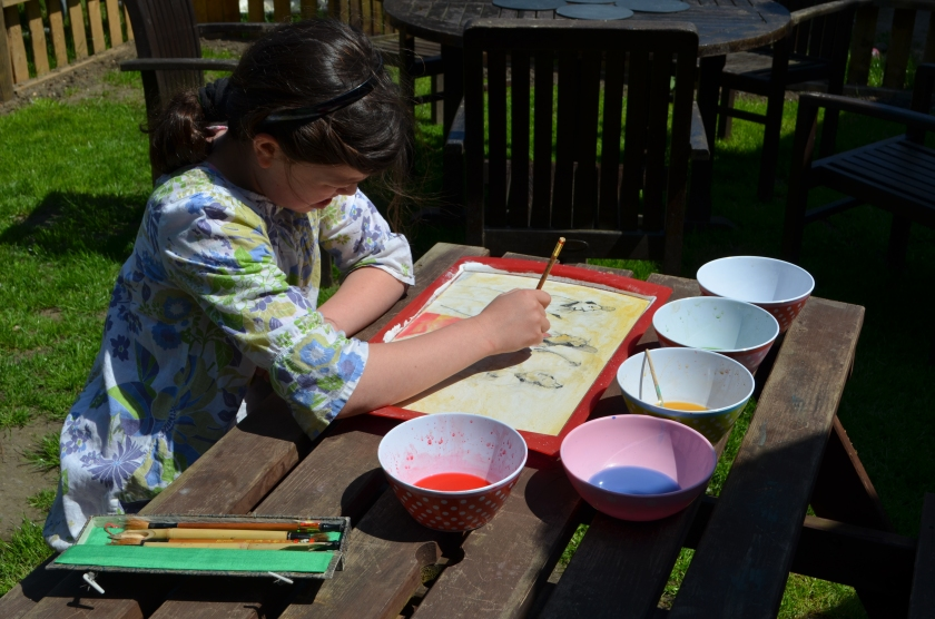 C10 enjoying her Chinese painting out of doors