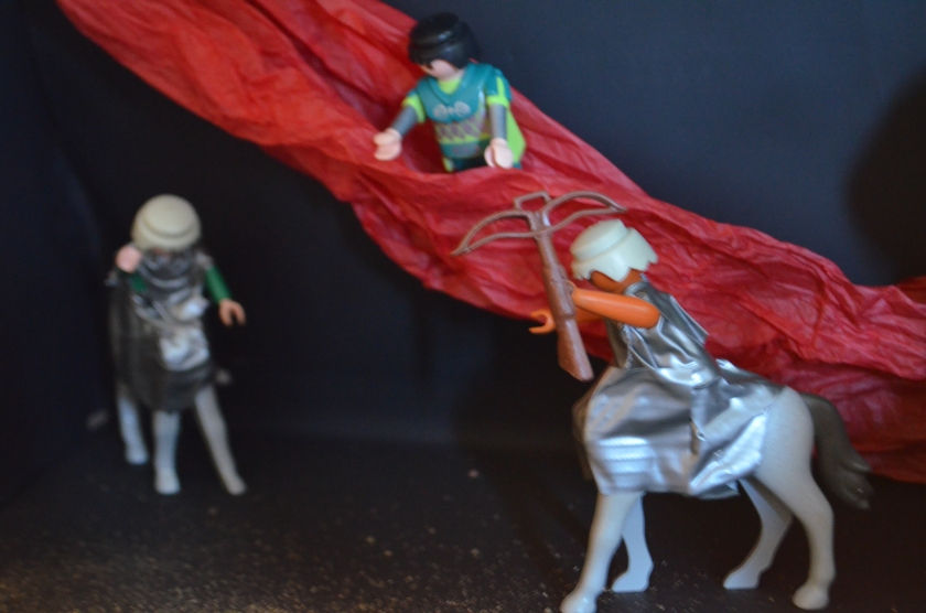 We used a strip of tissue paper for the boiling river, placing a man inside to boil for eternity.  Two centaurs with their bows and arrows guard the sinners, preventing them from escaping from their torment