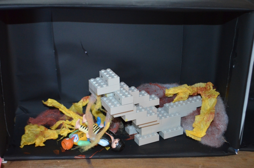 T11 made a three headed dog out of Lego, we made some discusting looking filth from paper and filling and placed two Play Mobil men under Cerberus.  The dog's slobber was made out of yellowed polyester filling