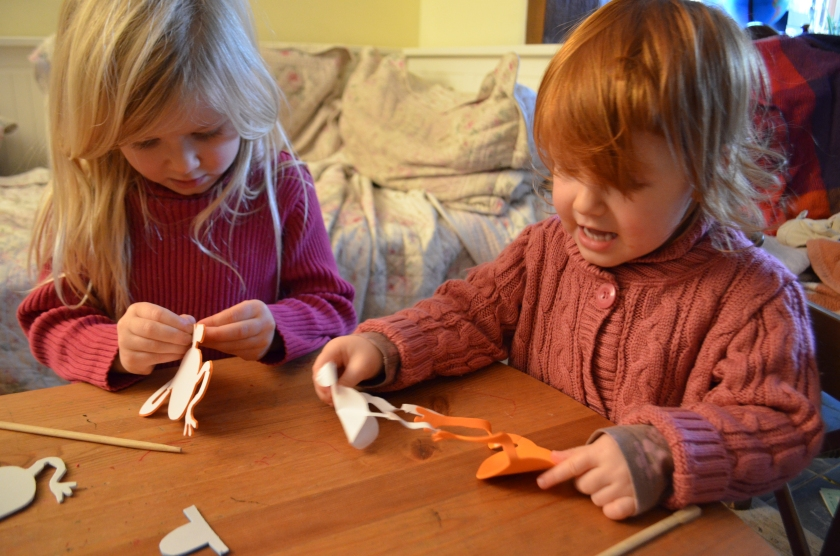 First the girls peeled off the paper from one of the Mr Tickle shapes