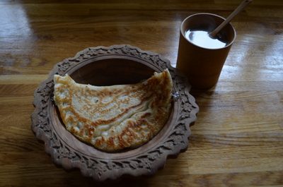 Arabic coffee warmed with Cardamon pods and cloves; served with pancakes with a cardamom, sugar and crushed almond filling
