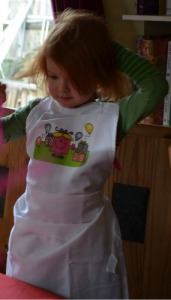 The birthday girl in her apron