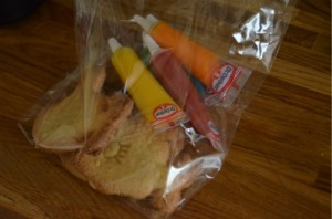 I made up a bag for each of the children, including some biscuits and some icing pens