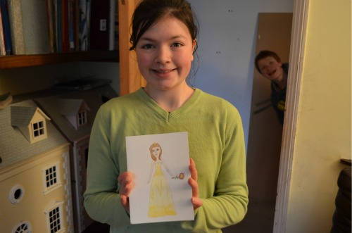 L11 painted me a picture of a girl holding a flower.  Isn't it brilliant?