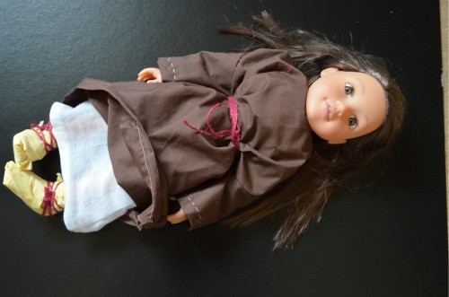 Here is her dolly with the chemise showing underneath, with the brown mantle over the top