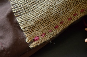 A detail of the hand stitched seam of the apron