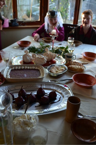 A photo showing all the deserts including the pear in red wine sauce