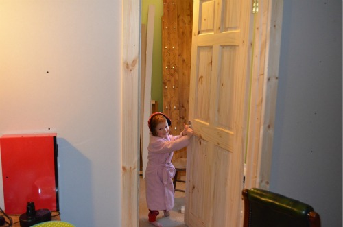 One of the helpers trying out hyer new door