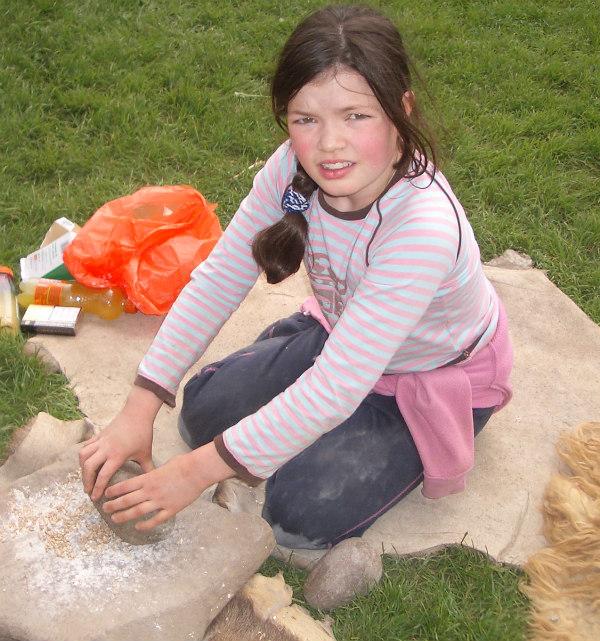 Butser Farm-celts-homeschool-field trip-grinding grain by hand